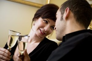couple having a drink and looking at each other 300x200 1
