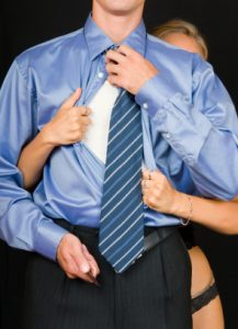 Executive with girl in stockings