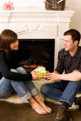 romantic couple fireplace & gift